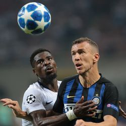 Serge Aurier (L) of Tottenham Hotspur competes for the ball with Ivan Perisic of FC Internazionale during the Group B match of the UEFA Champions League between FC Internazionale and Tottenham Hotspur at San Siro Stadium on September 18, 2018 in Milan, Italy.