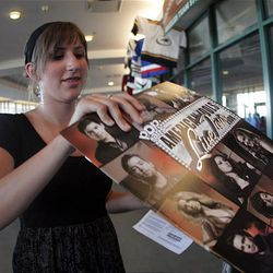 Sixteen-year-old Kelsee Hart buys a program before the American Idols Live concert at the E Center in West Valley on Monday night.