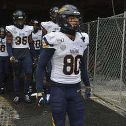 Bryce Mitchell leads the Toledo Rockets out of the makeshift tunnel.