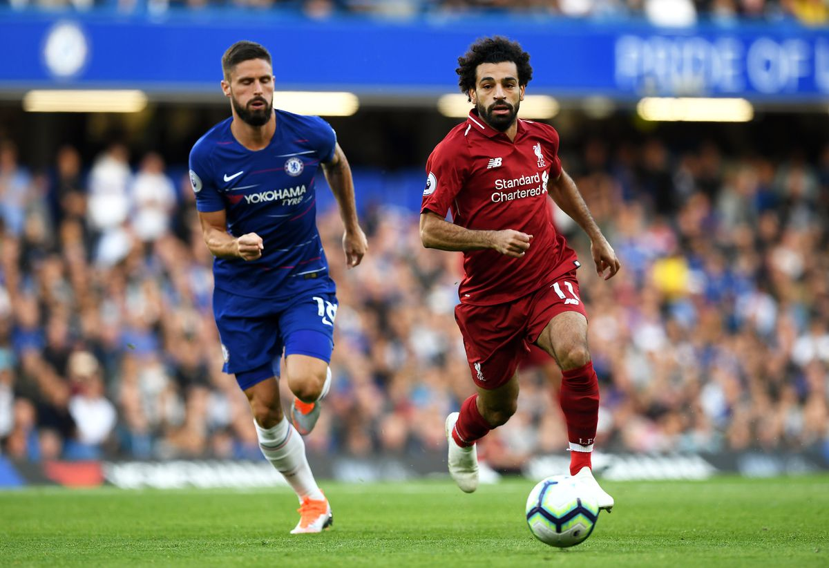 Mohamed Salah runs with the ball away from Olivier Giroud - Liverpool - Premier League