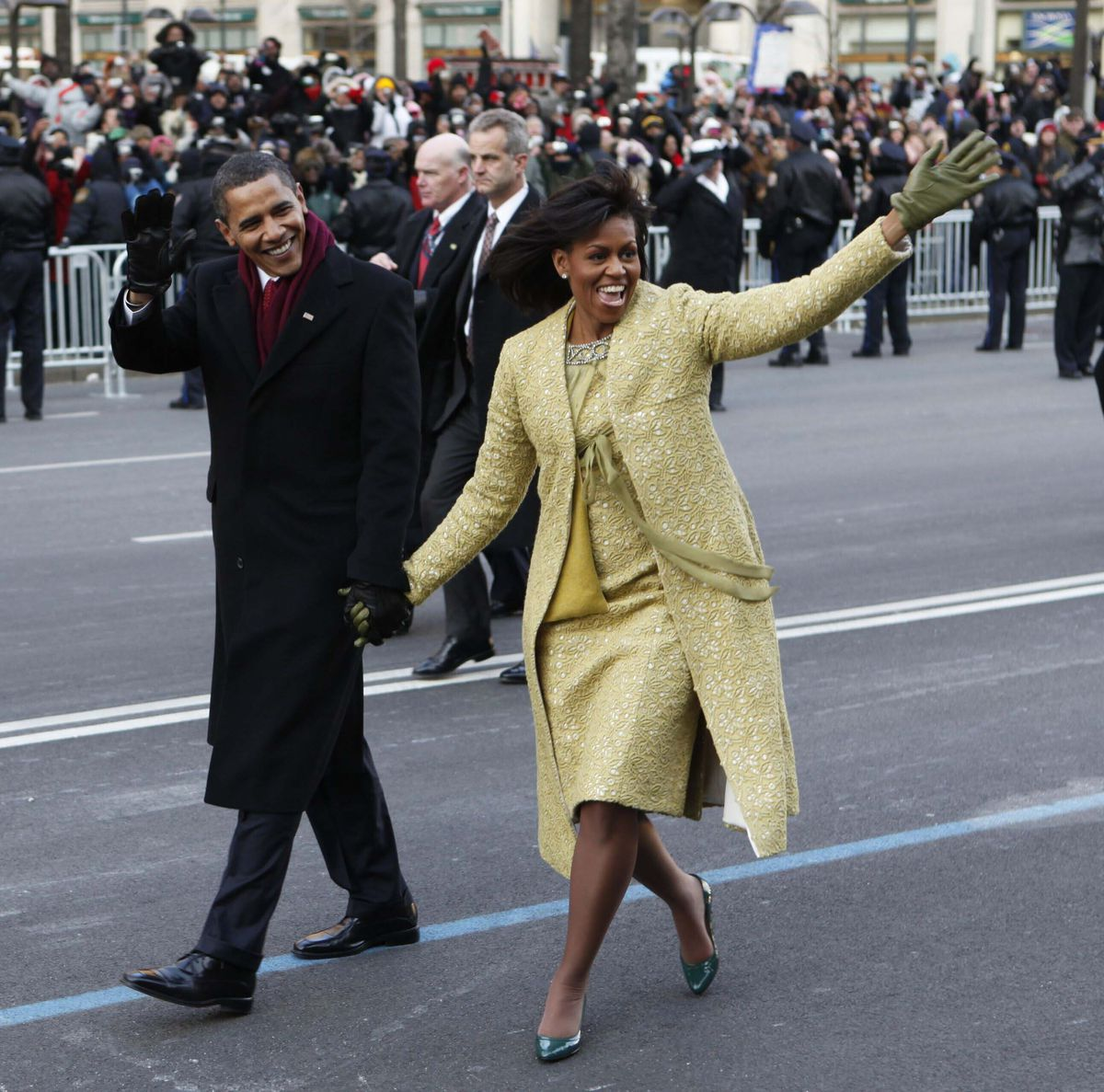 This Jan. 20, 2009, file photo shows President Barack Obama and first lady Michelle Obama, wearing a lemongrass-colored sheath dress and matching overcoat designed by Isabel Toledo as they walk the inaugural parade route in Washington, D.C.