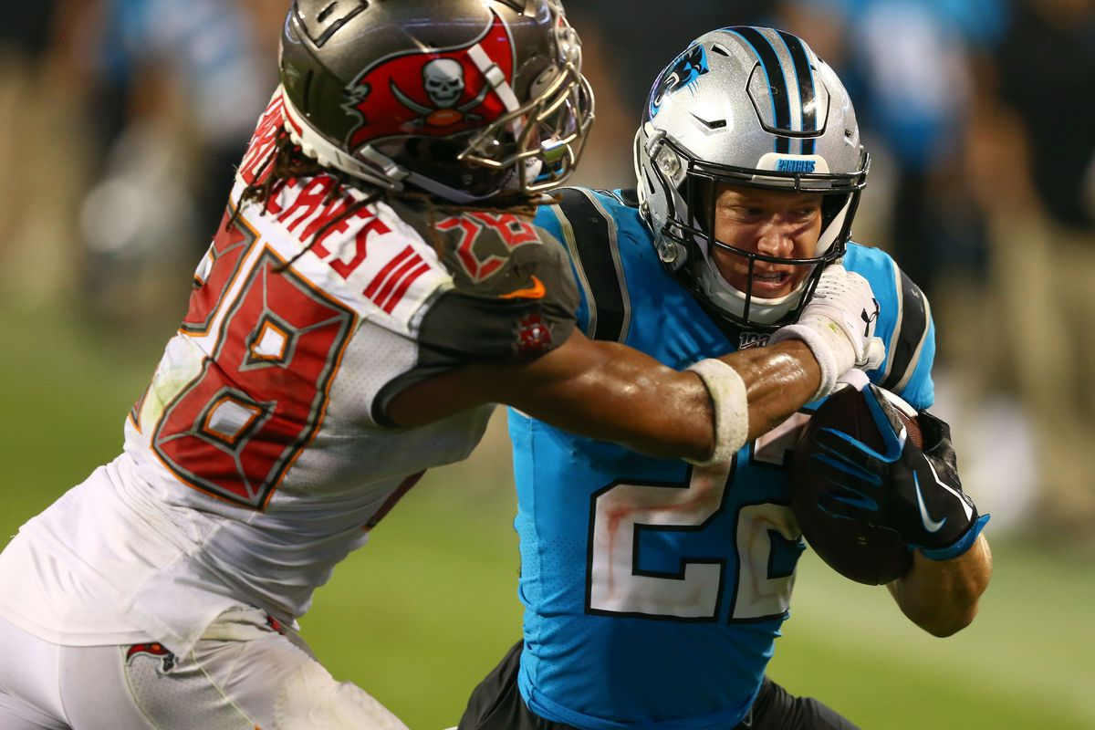 Carolina Panthers running back Christian McCaffrey is shoved out of bounds by Tampa Bay Buccaneers cornerback Vernon III Hargreaves during the fourth quarter at Bank of America Stadium.