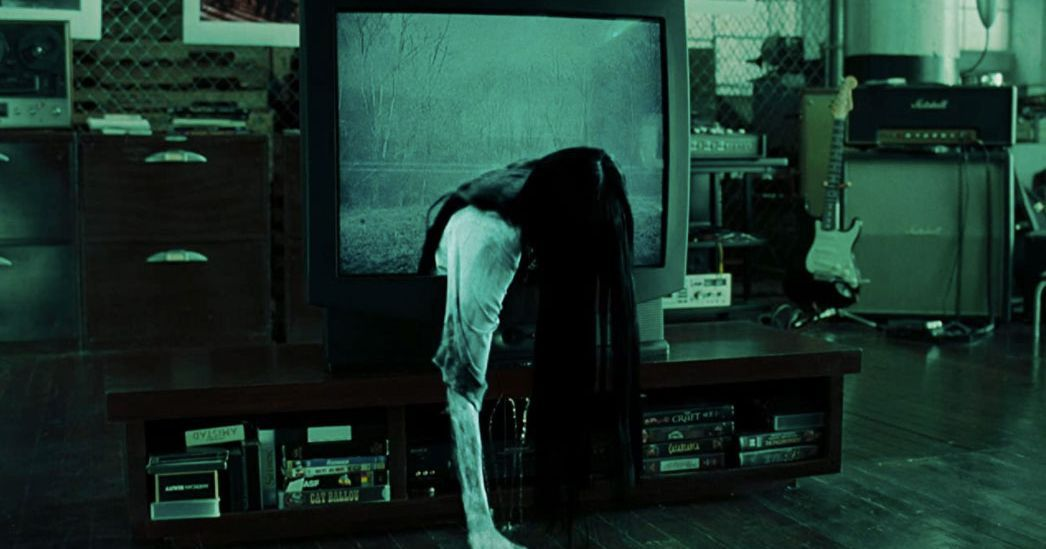 Sadako Yamamura crawling through a portal in a television
