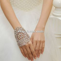 """<b>7. Diamond Cuff Gloves,</b> $55: These glittery cuff gloves work double-time as gloves and hand jewelry to amp up your look. Available online at: <a href=""""https://www.etsy.com/listing/184138802/bridal-elegant-gloves-bridal-cuffs?ref=shop_home_active_15"""