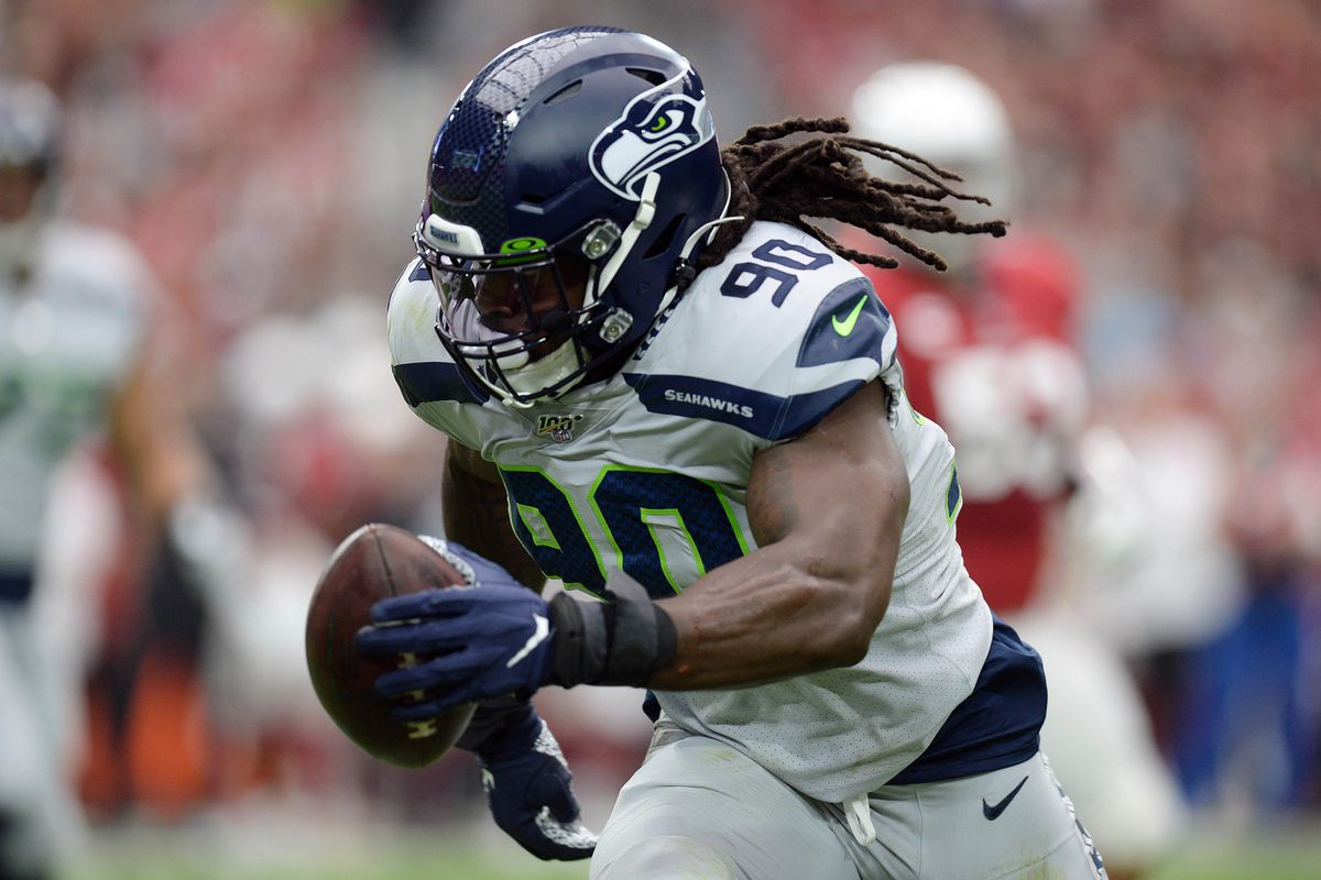Seattle Seahawks outside linebacker Jadeveon Clowney returns an interception for a touchdown against the Arizona Cardinals during the first half at State Farm Stadium.