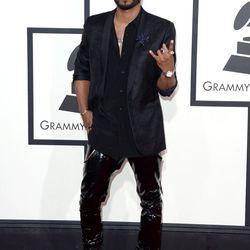 Miguel rocking a Dries Van Noten blazer over a Saint Laurent shirt and PVC skinny pants.