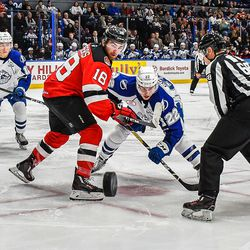 Syracuse Crunch Ross Colton (22) facing off against Binghamton Devils Blake Speers (18) in American Hockey League (AHL) action at the War Memorial Arena in Syracuse, New York on Friday, December 7, 2018. Syracuse won 5-0. © Scott Thomas Photography
