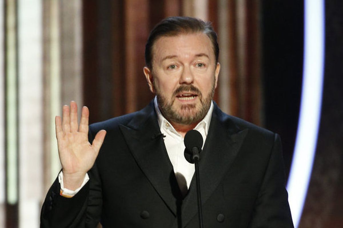 ricky gervais delivers a globes monologue with his hand raise and a whiskey at bay