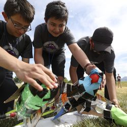 Prefreshman Engineering Program students Jesus R. Torres, left, Aquiles Torres and Kevin Narcizo Barajas prepare to launch their homemade rockets outside of Joel P. Jensen Middle School in West Jordan on Thursday, July 22, 2021. The summer enrichment program aims to introduce students to careers in STEM-related fields.