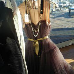 Dress, $249; necklace $29.95