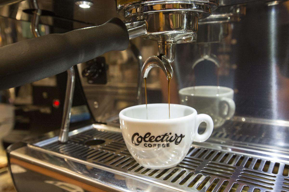 A coffee mug under a coffee machine.
