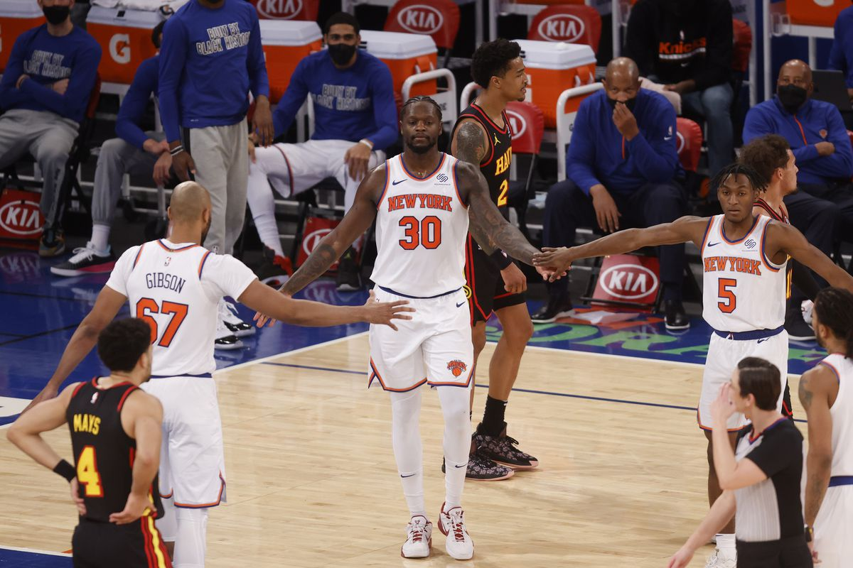 New York Knicks' Julius Randle is congratulated by teammates Taj Gibson and Immanuel Quickley during the third quarter at Madison Square Garden.