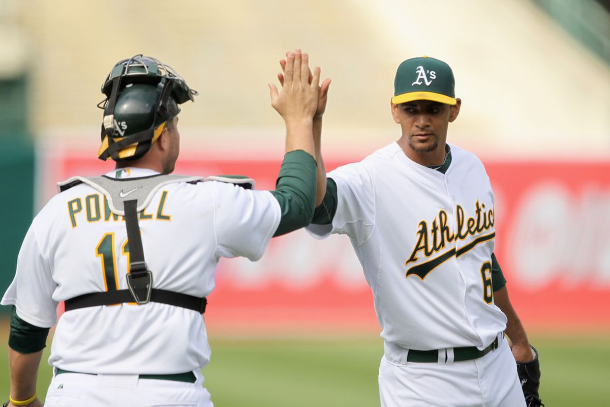 Tyson Ross congratulated by Landon Powell of the Oakland Athletics after they beat the Detroit Tigers on April 17, 2011 in Oakland, California.  (Photo by Ezra Shaw/Getty Images)