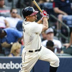 Atlanta Braves' Reed Johnson (11) hits a two-RBI double in the sixth inning of a baseball game against the Philadelphia Phillies, Sunday, Sept. 2, 2012, in Atlanta.