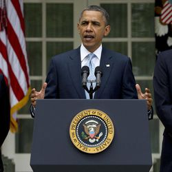 President Barack Obama, flanked by Treasury Secretary Timothy Geithner, left, and Attorney General Eric Holder, speaks in the Rose Garden at the White House in Washington, Tuesday, April 17, 2012, about a plan to increase oversight and crack down on manipulation in oil markets.