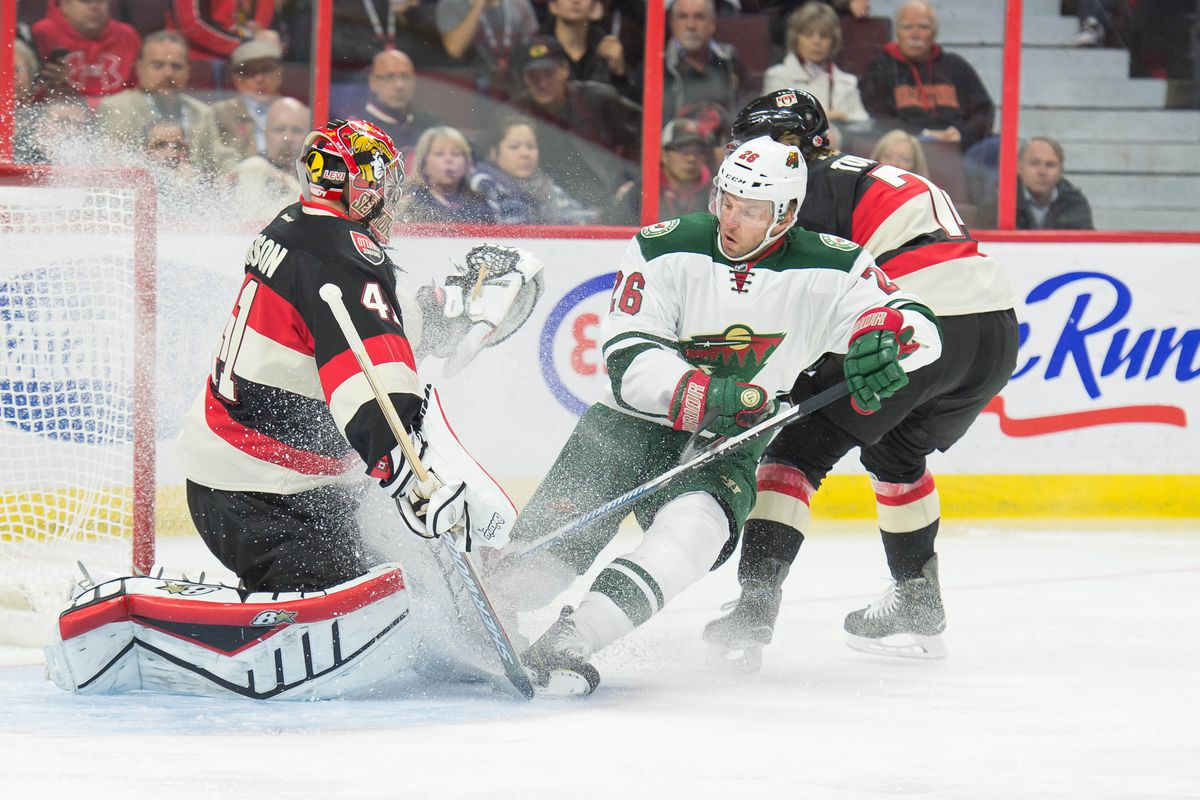 Ryan Suter, trying to cool down Craig Anderson's hot streak.