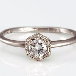 """Catbird's white diamond <a href=""""https://catbirdnyc.com/shop/product.php?productid=17606&cat=0&page=1"""">hexagon ring</a>, $590"""
