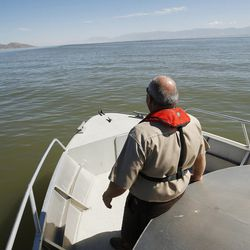 Utah DNR's Eugene Swalberg looks over the view of the Great Salt Lake on Friday, Sept. 2, 2016. The marina was last dredged in 2008 and needs to be dredged another 5 feet.