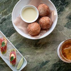 Tuna tartare tacos and raspberry doughnuts