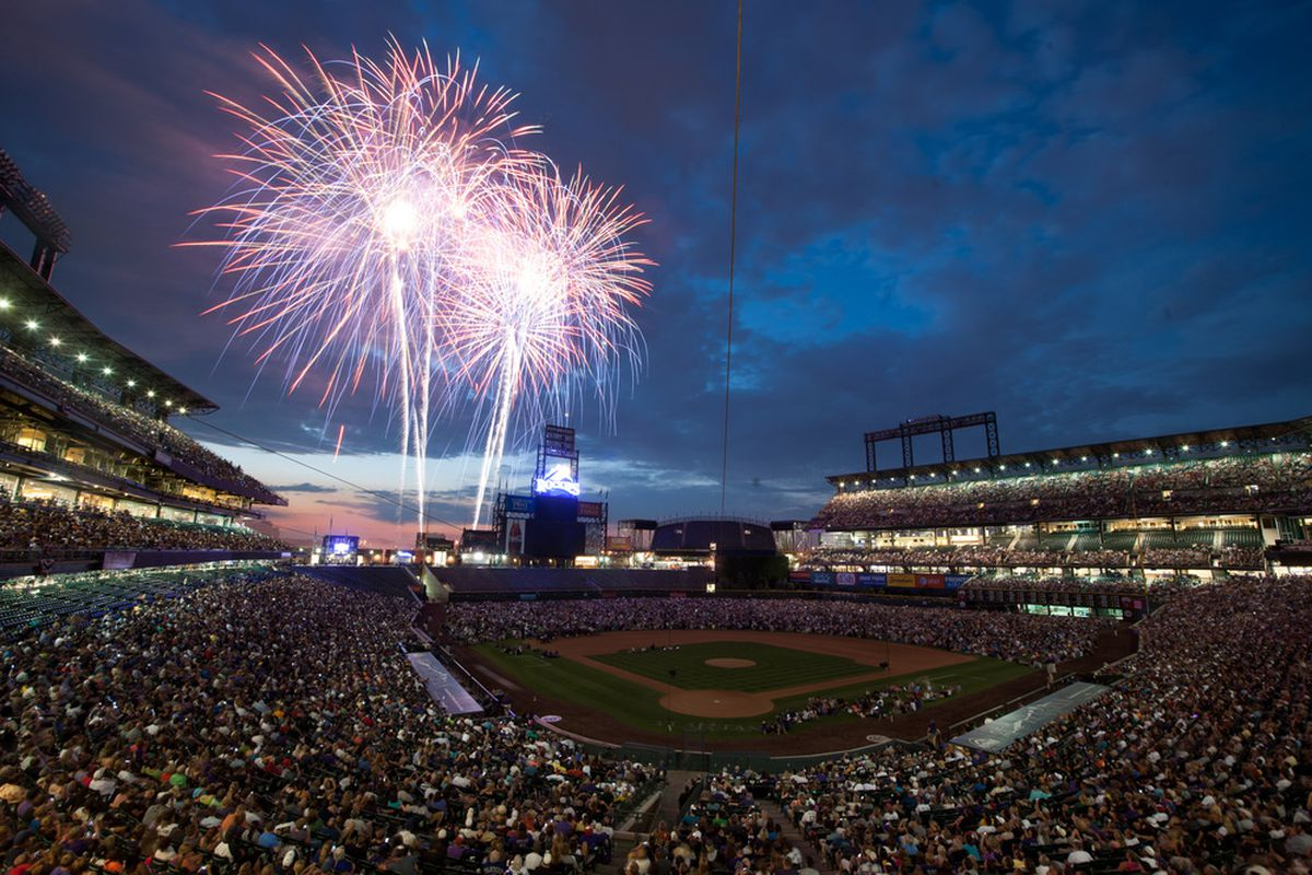 DENVER, CO - JUNE 30:  Baseball fans watch a fireworks show after a game between the San Diego Padres and the Colorado Rockies at Coors Field on June 30, 2012 in Denver, Colorado.  (Photo by Dustin Bradford/Getty Images)