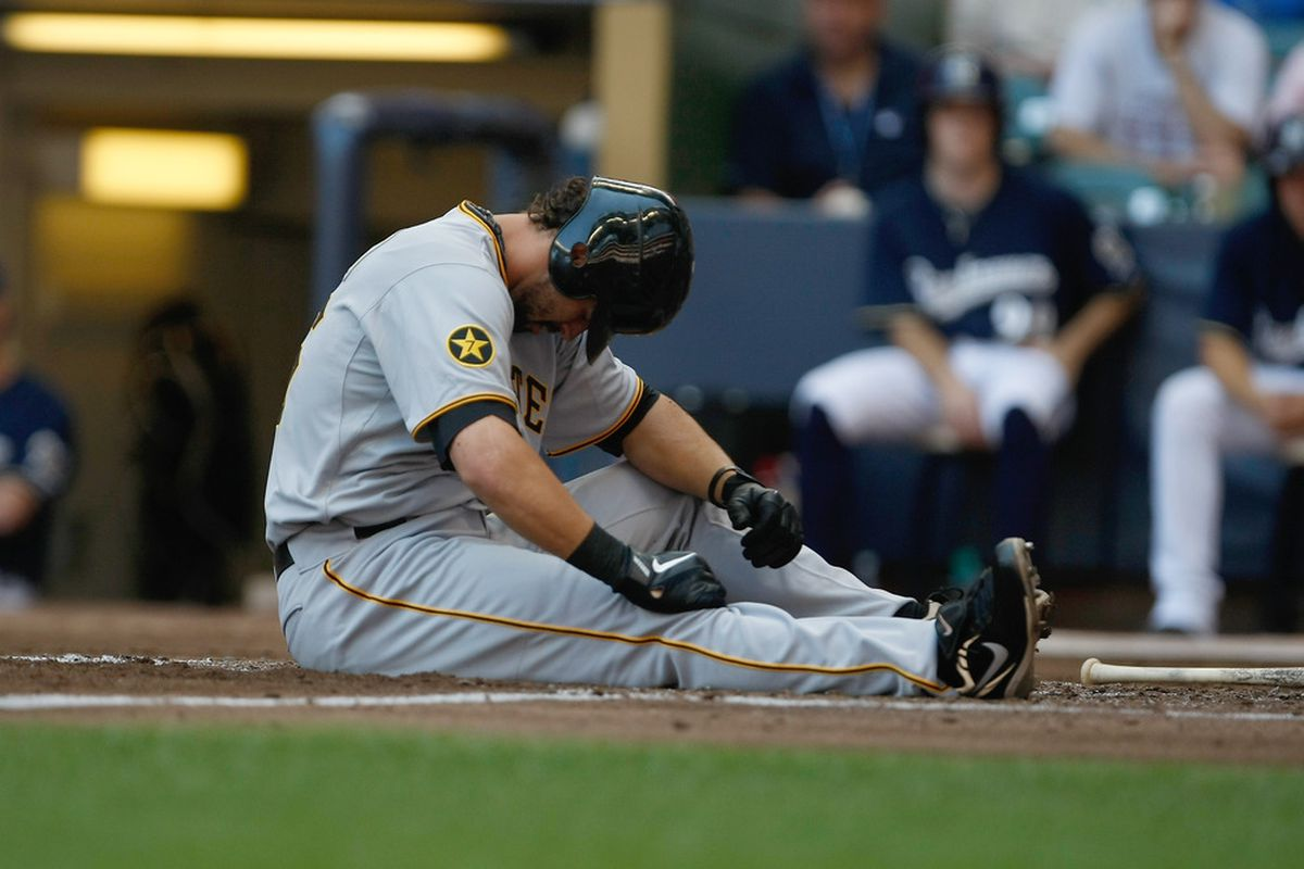 MILWAUKEE, WI - AUGUST 14: Garrett Jones #46 of the Pittsburgh Pirates sits on the ground after being injured against the Milwaukee Brewer at Miller Park on August 14, 2011 in Milwaukee, Wisconsin. (Photo by Scott Boehm/Getty Images)