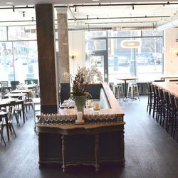 The front dining room view from the center dining space, located next to the open kitchen.
