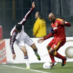 Jamison Olave of Real Salt Lake battles for control of the ball against Tony Cascio of the Colorado Rapids during their MLS match up at Rio Tinto Stadium in Sandy Saturday, April 7, 2012.