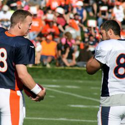 Peyton Manning and Broncos tight end Jacob Tamme preparing to go to work.