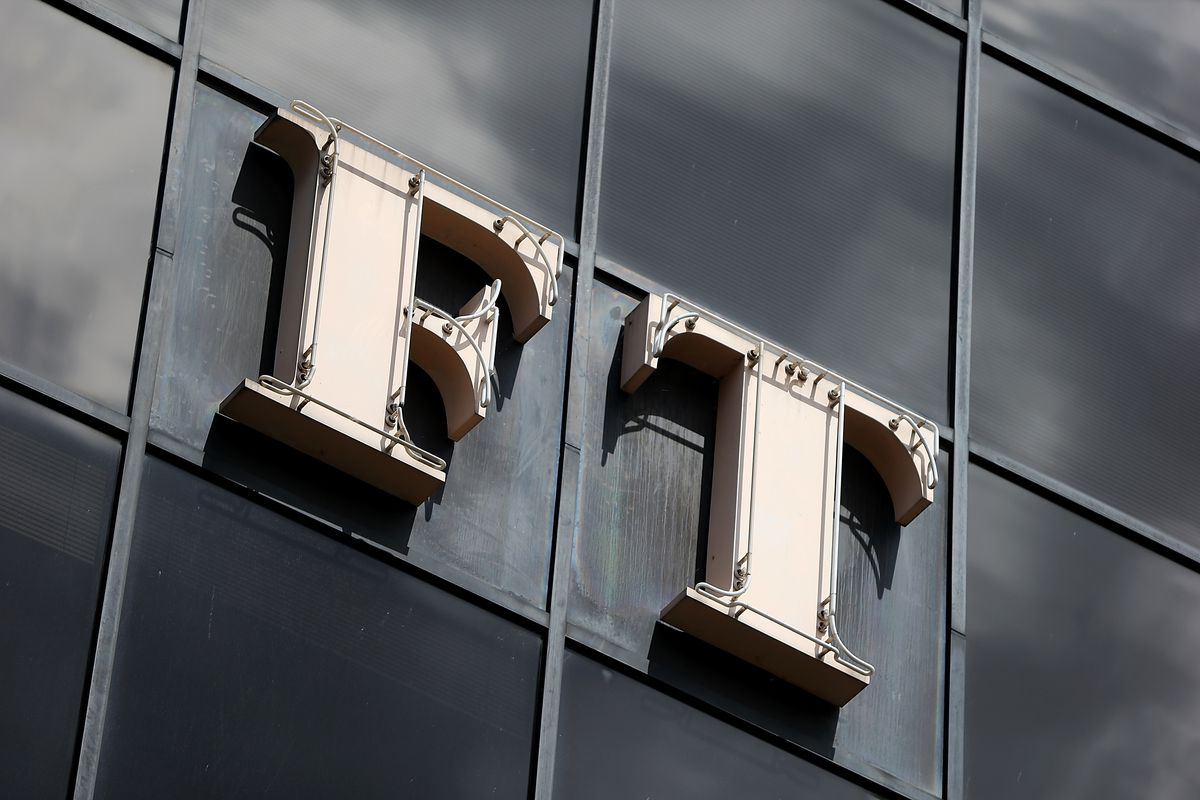FT, the logo of the Financial Times, on the side of a building