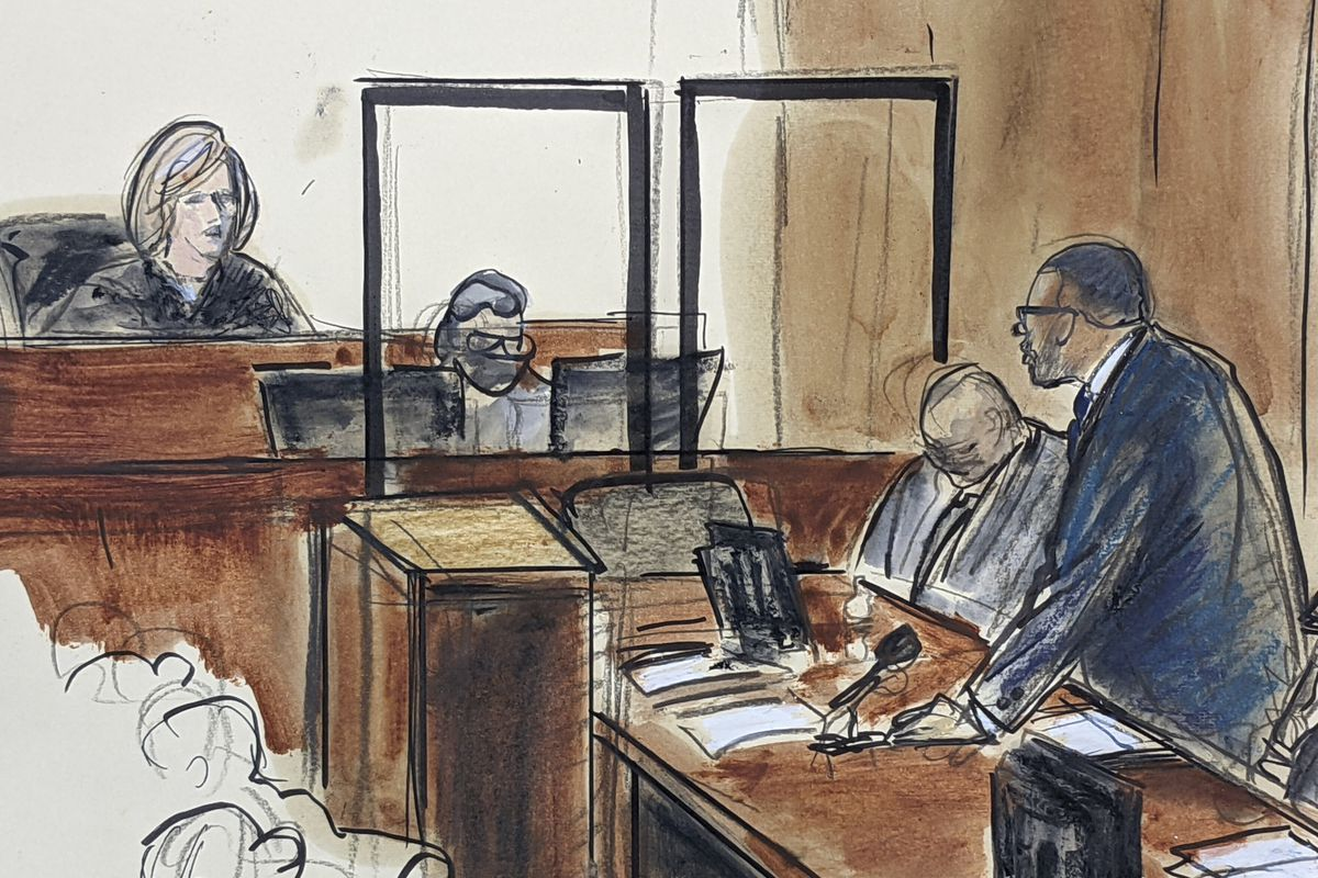In this illustration drawn from a video feed, R. Kelly, right, stands and responds to Judge Ann Donnelly's question whether or not he has decided to take the stand in his own defense, Wednesday, Sept. 22, 2021, in New York.