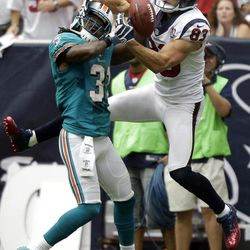 Houston Texans wide receiver Kevin Walter (83) reaches for a pass as Miami Dolphins defensive back Richard Marshall (31) defends in the second quarter of an NFL football game on Sunday, Sept. 9, 2012, in Houston. Marshall was called for pass interference on the play.