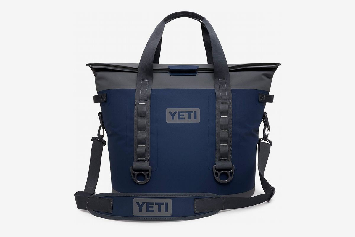 A navy blue and gray soft Yeti cooler