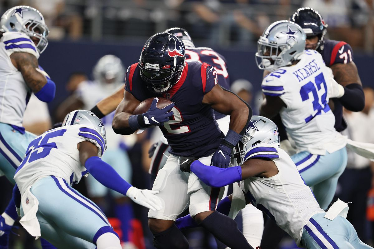 Houston Texans running back Mark Ingram (2) runs the ball against the Dallas Cowboys in the first half of a NFL preseason game at AT&T Stadium.