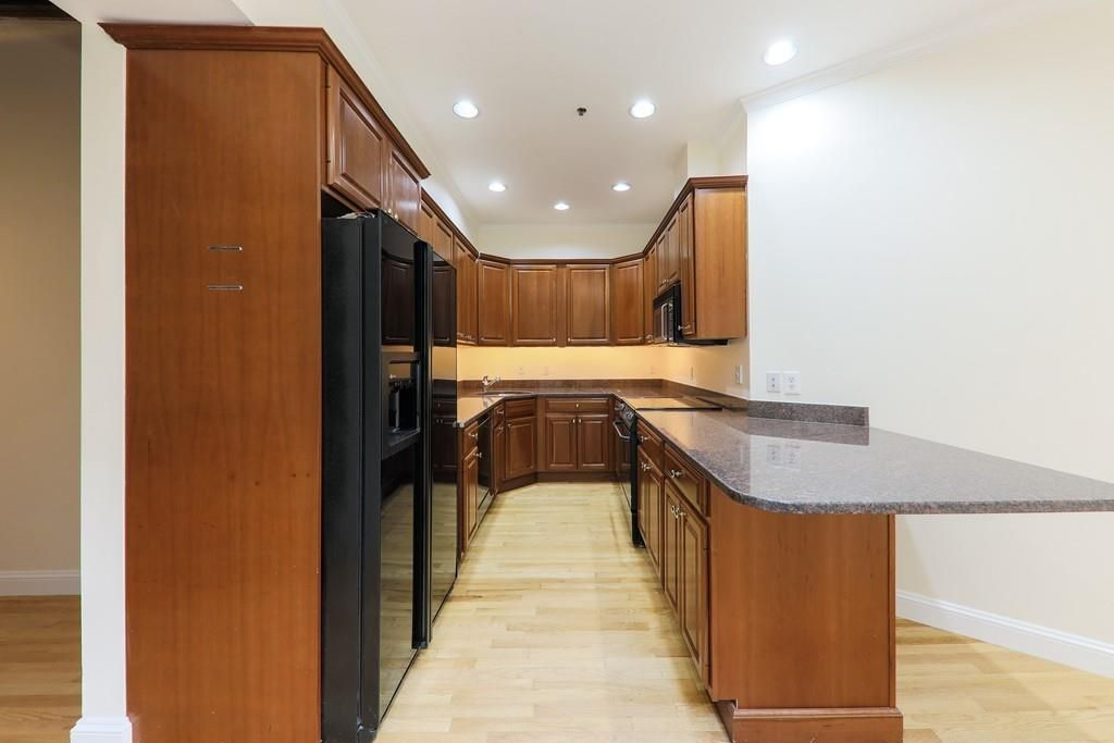 The kitchen off the living room, with a narrowly done U-shaped counter.