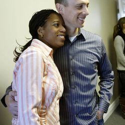 Saratoga Springs Mayor Mia Love hugs her husband, Jason, after talking Thursday, Dec. 22, 2011 about her plans to run for Congress at what will become her campaign headquarters in South Jordan.
