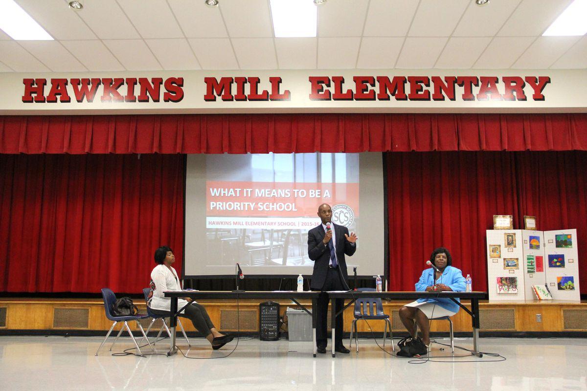 Superintendent Dorsey Hopson, flanked by school board members Stephanie Love and Teresa Jones, speaks at a priority school community meeting in Memphis.