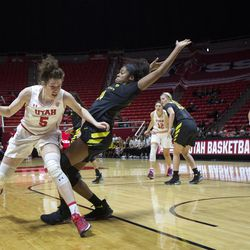 Utah Utes forward Megan Huff (5) fouls Oregon Ducks forward Ruthy Hebard (24) during the Utes' 84-68 loss to the Oregon Ducks at the Jon M. Huntsman Center in Salt Lake City on Sunday, Jan. 28, 2018.