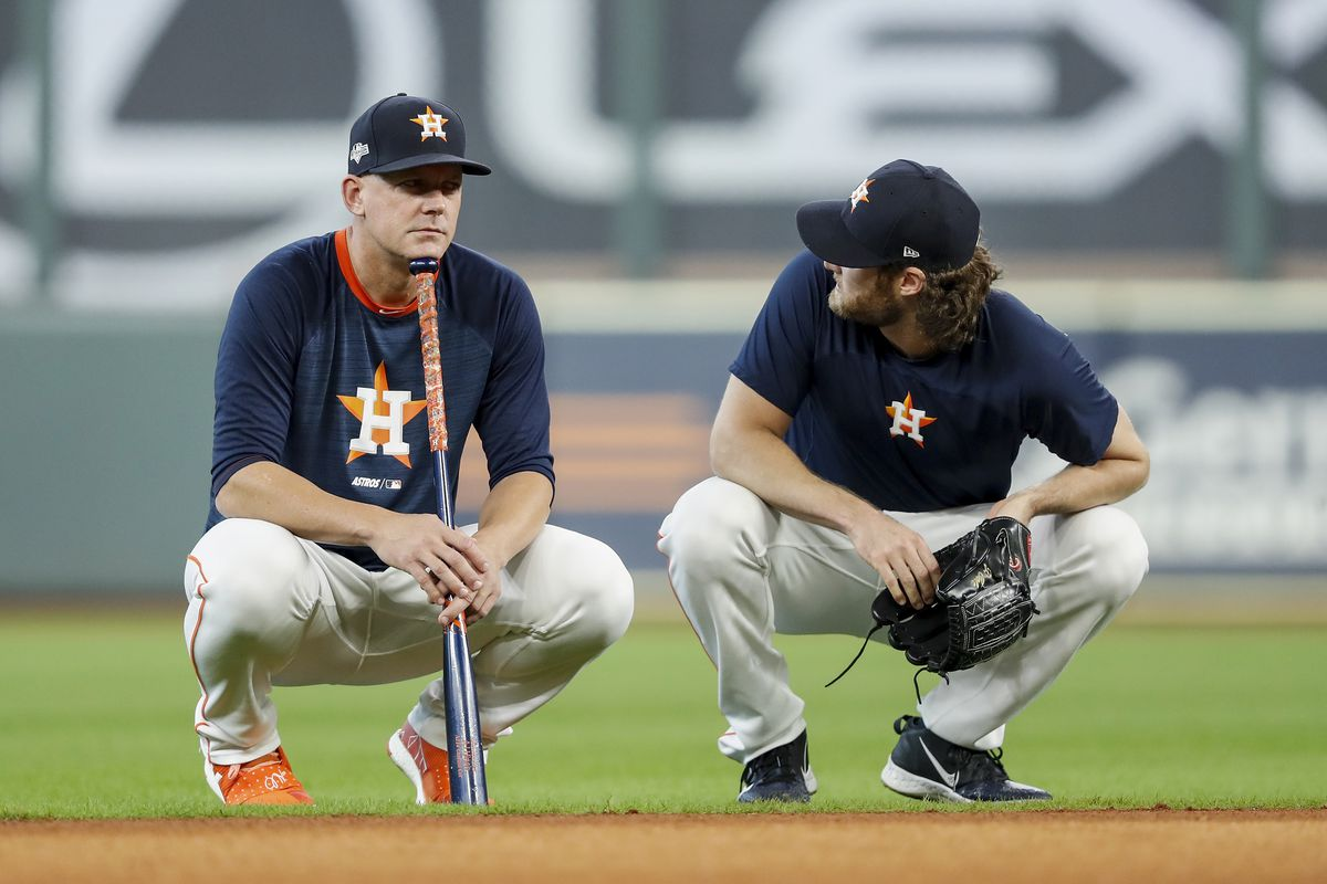 Gerrit Cole of the Houston Astros talks with manager manager AJ Hinch before Game Six of the League Championship Series against the New York Yankees at Minute Maid Park on October 19, 2019 in Houston, Texas.