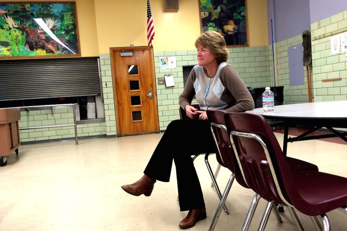 Anne Rowe, vice president of the Denver Public Schools Board of Education, sits on the sidelines during a March town hall meeting at Merrill Middle School on The Denver Plan. Rowe has led the board's work on updating the district's strategic document.