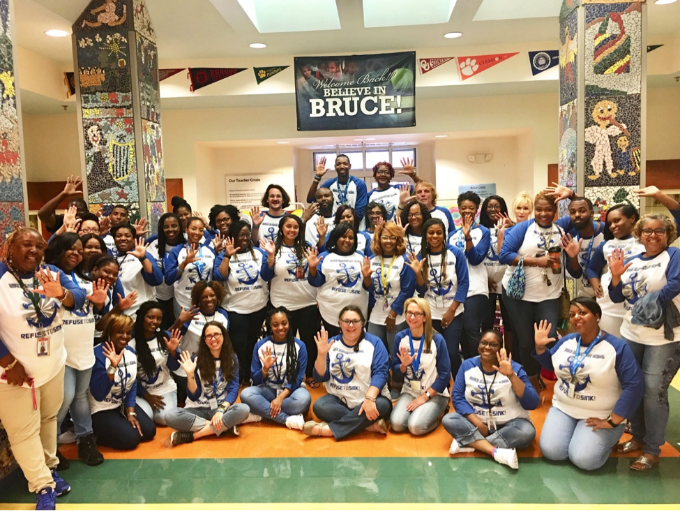 Staff at Bruce Elementary School celebrate getting the state's highest score for student growth.