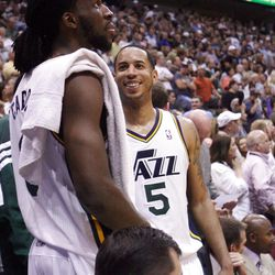 Utah Jazz guard Devin Harris (5) and teammate Utah Jazz forward DeMarre Carroll (3) talk in the final few moment of the game as the Utah Jazz and the Phoenix Suns play Tuesday, April 24, 2012 in Energy Solutions arena. Utah won 100-88.