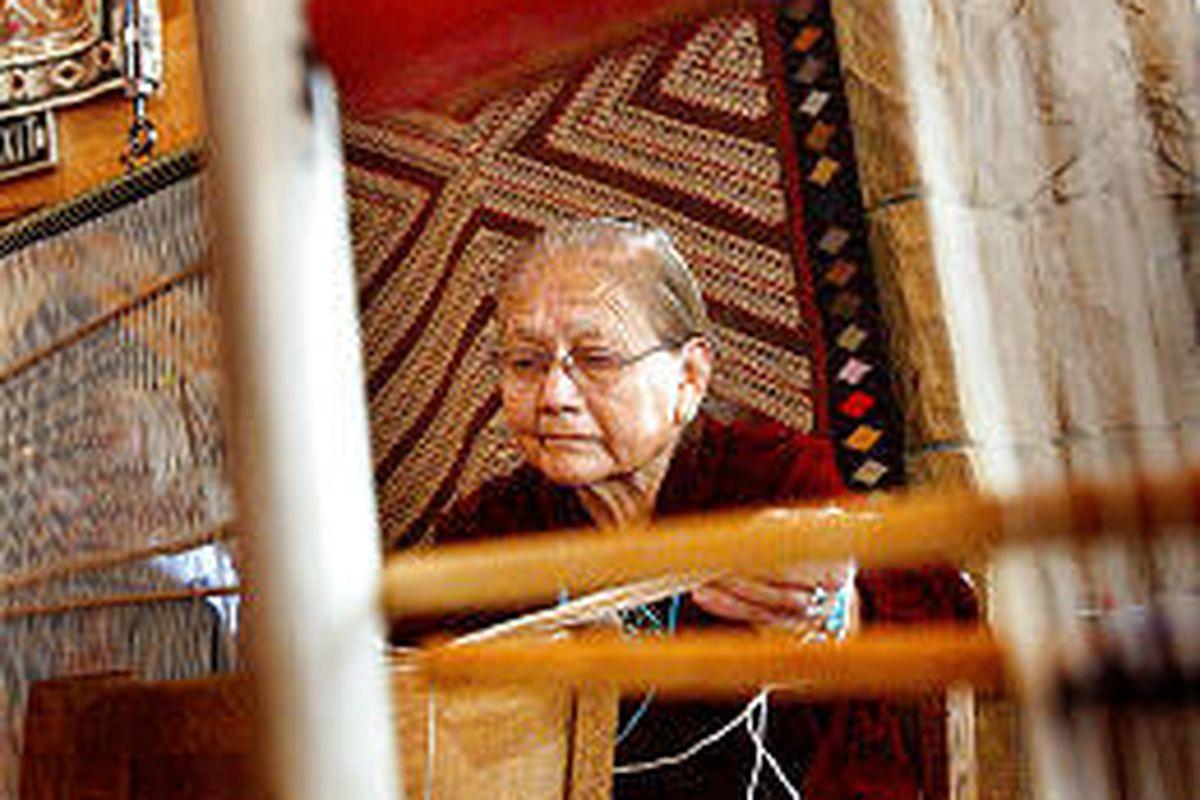 Anna Jackson of Teestone, Ariz., weaves a rug Thursday at Deer Valley's Snow Park Lodge.