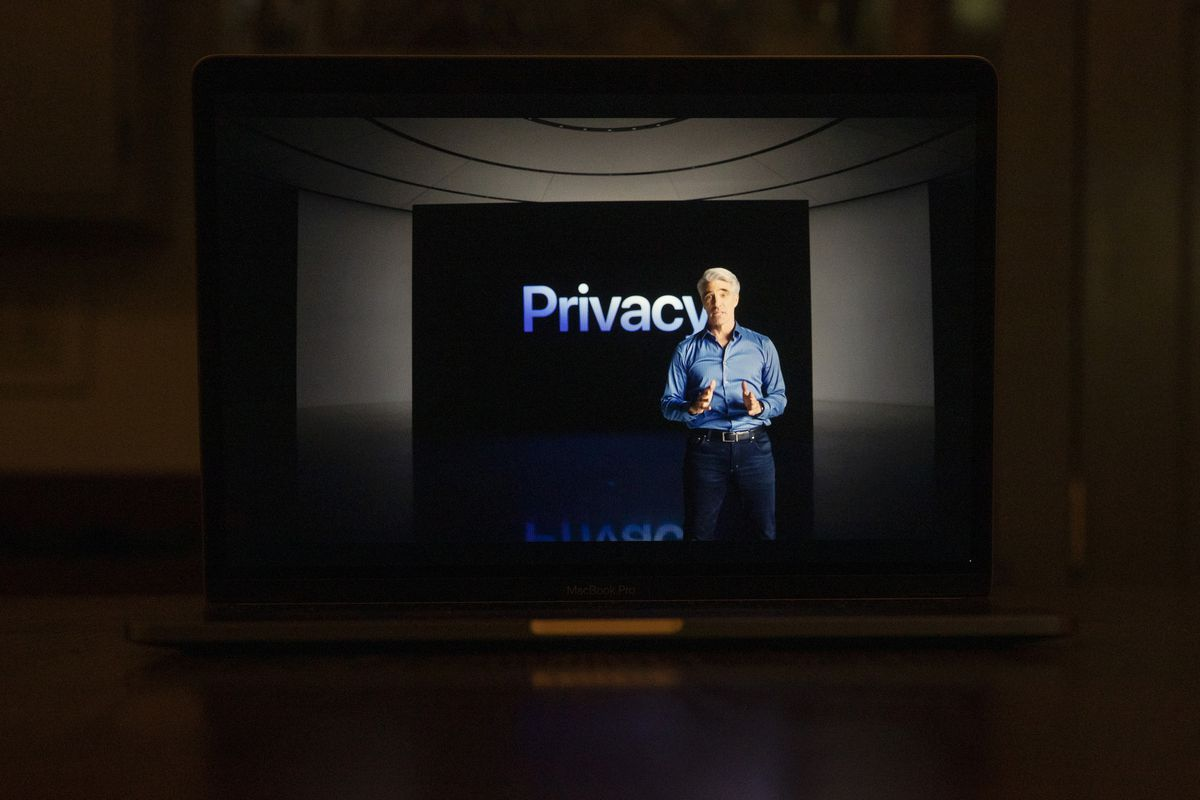 """Apple's senior vice president of software engineering, Craig Federighi, stands in front a screen that reads, """"Privacy."""""""