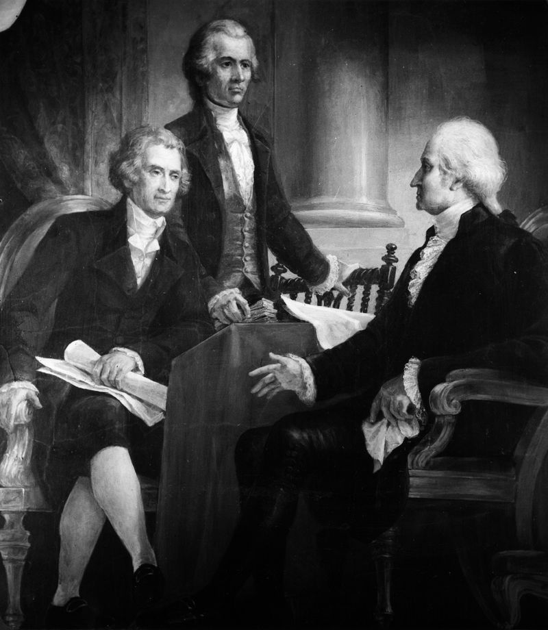 A drawing of George Washington with Thomas Jefferson and Alexander Hamilton.