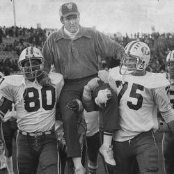 BYU head football coach LaVell Edwards is carried by Mekeli Leremia and Steve Dewey after beating Utah 34-12 Nov. 11, 1976.