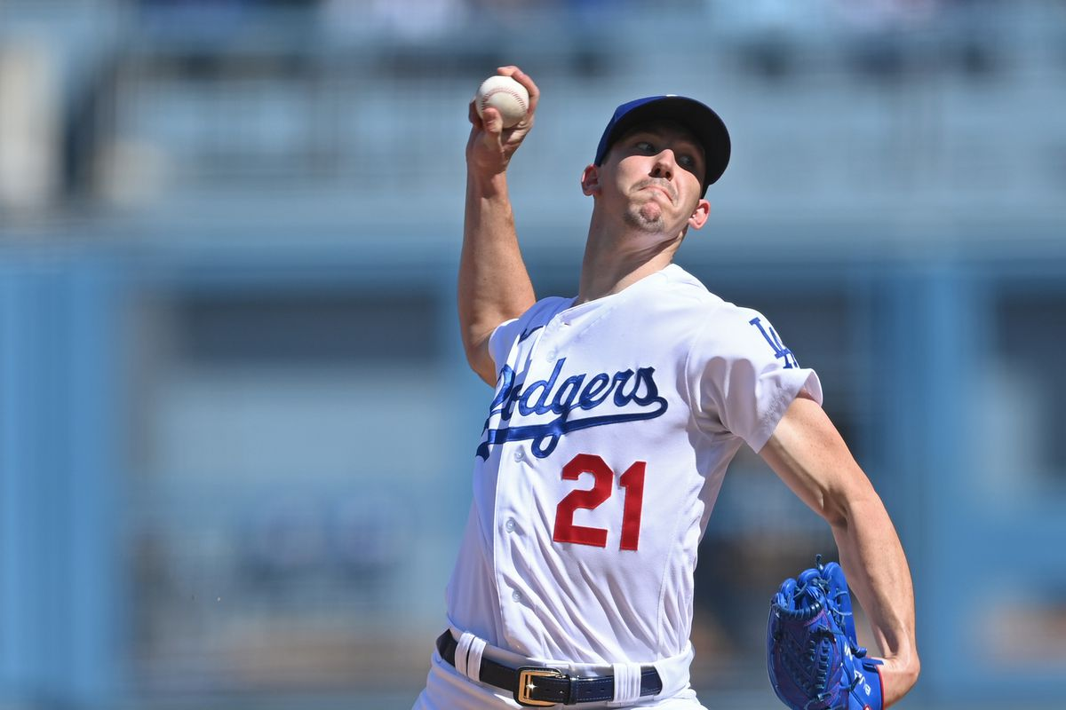 Los Angeles Dodgers starting pitcher Walker Buehler (21) pitches his 11th strike out of the game in the fifth inning against the Milwaukee Brewers at Dodger Stadium.