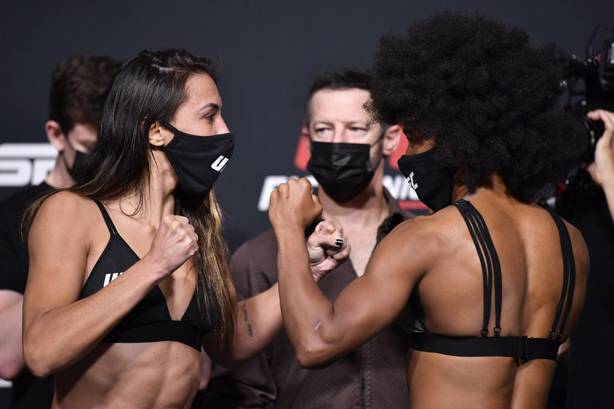 Opponents Amanda Ribas of Brazil and Angela Hill face off during the UFC weigh-in at UFC APEX on May 07, 2021 in Las Vegas, Nevada.