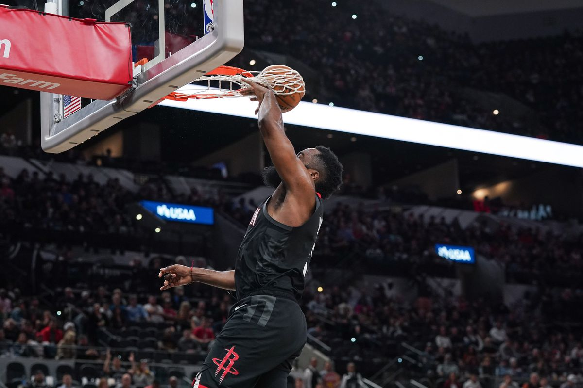 Houston Rockets guard James Harden's dunk in the second half wraps through the basket during the game against the San Antonio Spurs at the AT&T Center. The basket was not credited to Harden.
