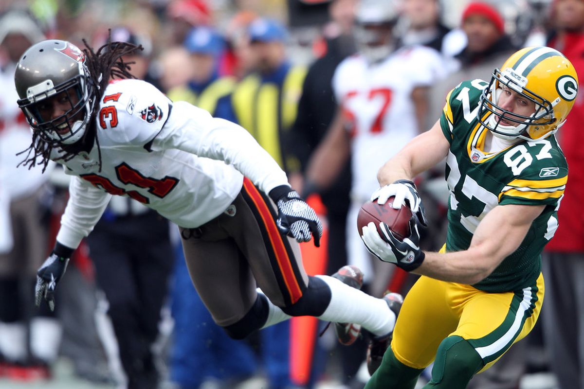 GREEN BAY, WI - NOVEMBER 20:  Jordy Nelson #87 of the Green Bay Packers makes the catch as  E.J. Biggers #31 of the Tampa Bay Buccaneers defends  on November 20,2011 at Lambeau Field in Green Bay, Wisconsin.  (Photo by Elsa/Getty Images)