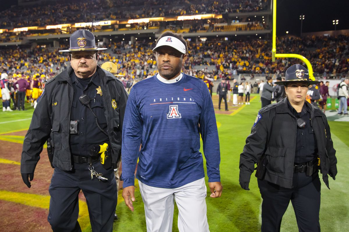 Arizona Wildcats head coach Kevin Sumlin leaves the field after losing to the Arizona State Sun Devils in the Territorial Cup at Sun Devil Stadium.